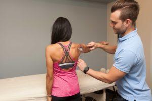 Greg taking measurements on back